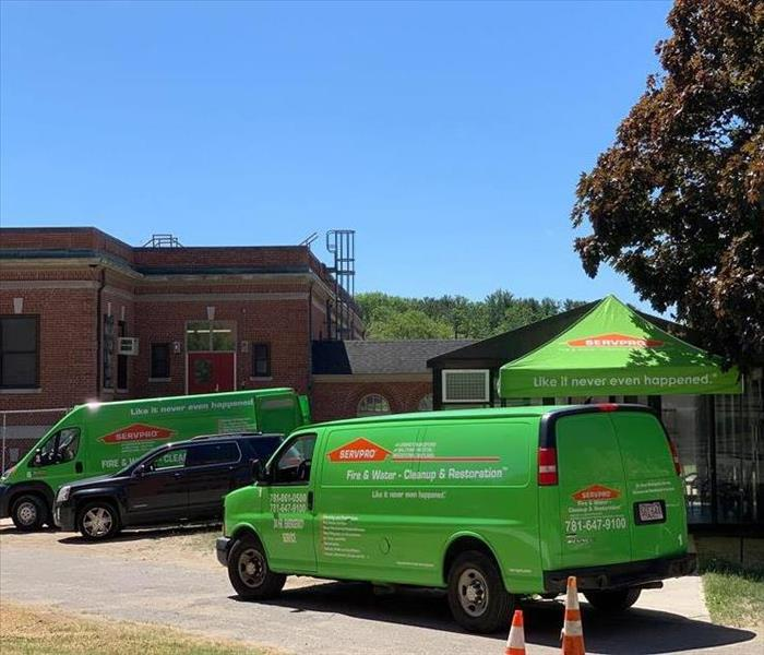 Our SERVPRO trucks outside a job